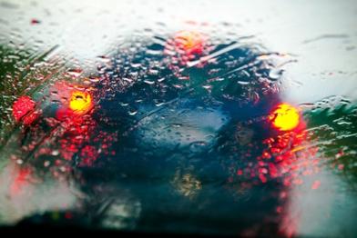 Car windshield in traffic jam during rain